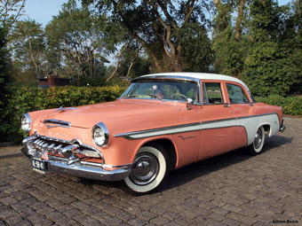 This 1955 DeSoto FireDome illustrates the transitional styling of early 1950s autos to the sleeker, flatter sides of mid-50s design. It also clearly shows an imaginative two-toned color breakdown, in shades not seen before that era.